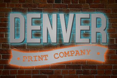 image of denver print company backlit sign on brick