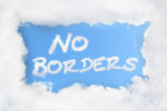 """no borders"" written in clouds"
