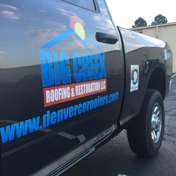 Truck door vinyl graphics Big Creek Roofing