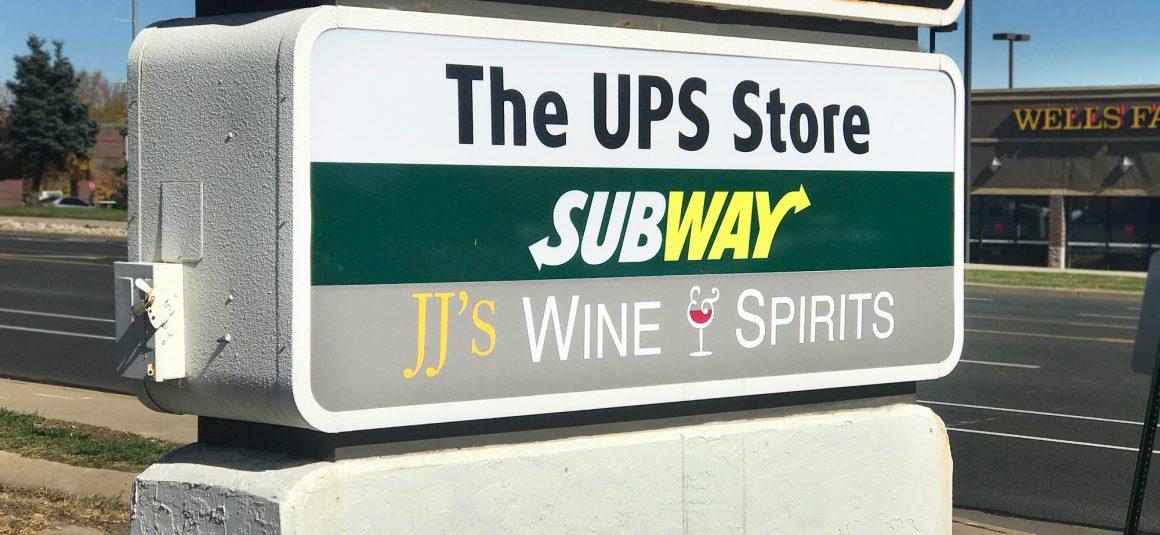 jj wine and liquor vinyl adhesive sign