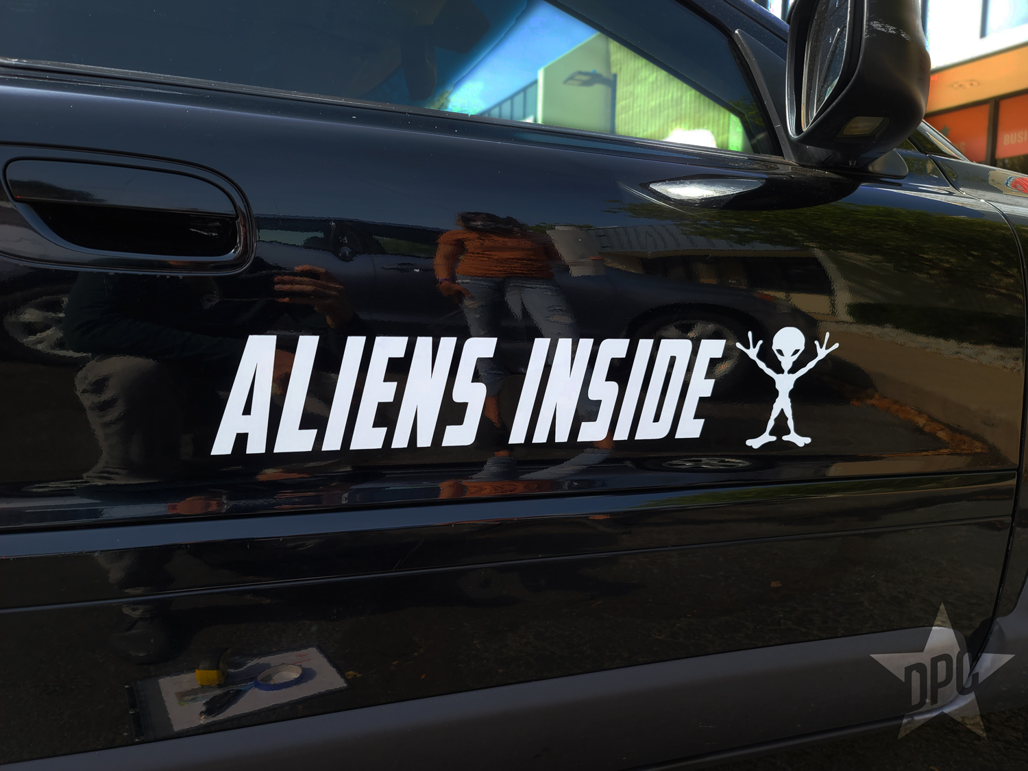"""Aliens inside"" car door graphics by Denver Print Company"