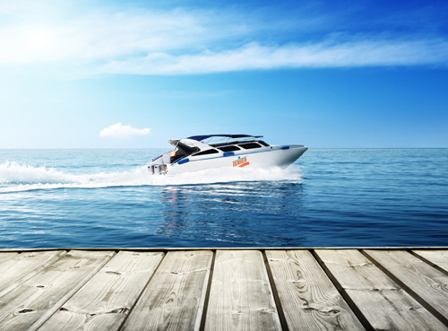 Boat in water with custom graphics by Denver Print Company