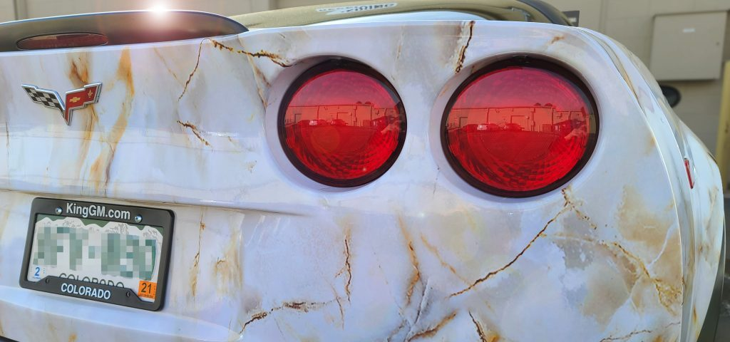 Full corvette wrap in marble pattern. Taillight view.