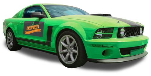 Car magnet on green muscle car