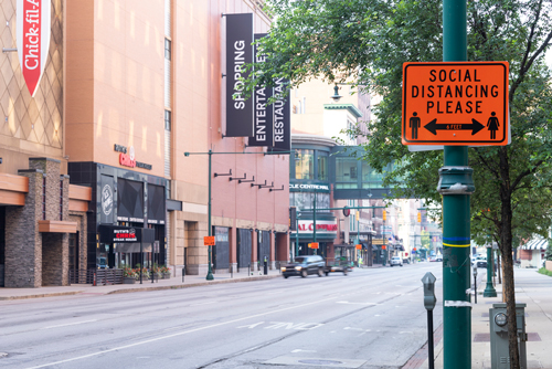 social distancing street sign in denver