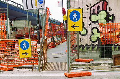 urban roadwork with sign for pedestrian and traffic
