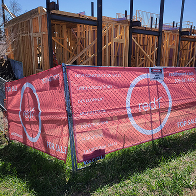 mesh banner on construction site fence
