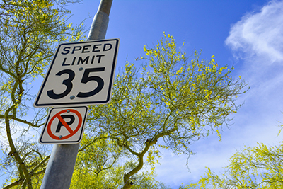 metal speed limit sign on pole