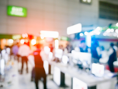 blurry image of trade show floor